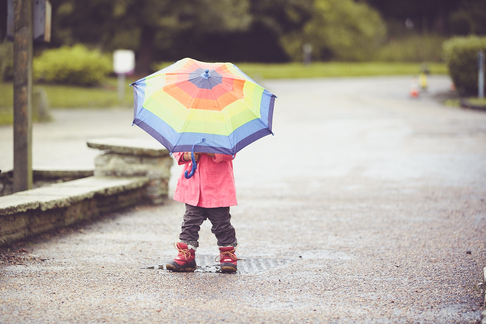 "You can end up with fun lifestyle photos when having your children""s photos taken in the rain"