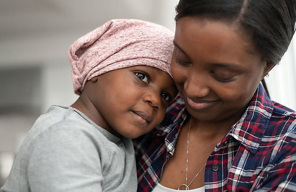 mother-of-african-descent-cuddles-her-child-who-has-cancer.jpeg