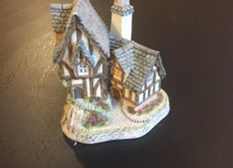 A collection of 67 David Winter miniature houses