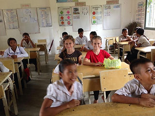 Family travel. Children sit in a classroom in a village in Cambodia