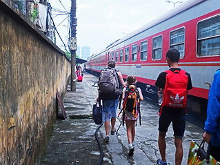 Family travel. A family arrives at the train station in Hanoi, Vietnam