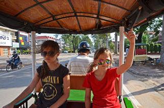 Family travel: children in a tuk-tuk, Siem Reap, Cambodia