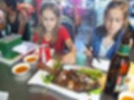 Family travel: children eat in a restaurant in Yangon, Myanmar