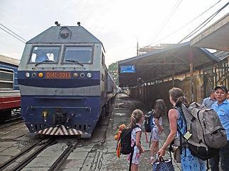 Family travel: arriving at the train station in Hanoi, Vietnam