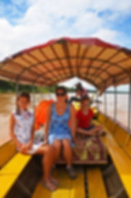 Family travel: dolphin watching in the Mekong, Cambodia