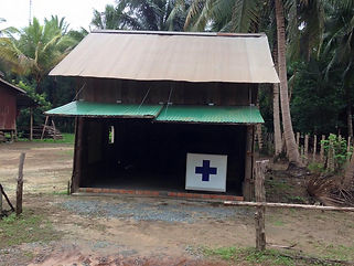 Family travel: medical hut, Cambodia
