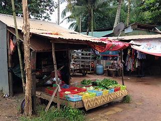 Family travel: market stall, Cambodia