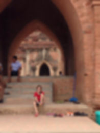 Family travel: putting shoes on, Bagan