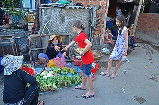 Family travel: buying fruit, Vietnam