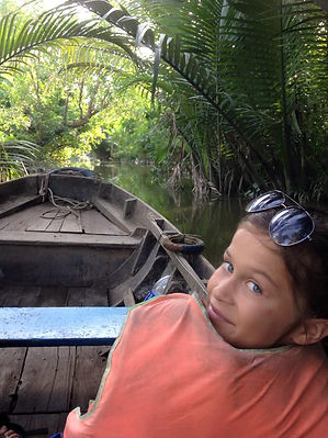 Family travel: a boat ride in the Mekong Delta