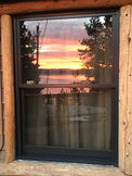 Sunset reflection in window.JPG