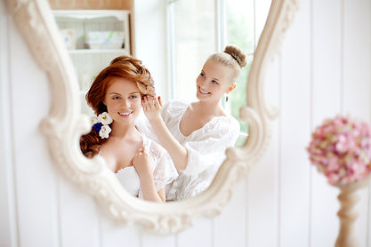 Hair stylist makes the bride on the wedding day .jpg