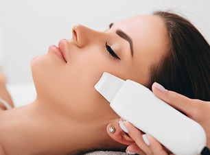 Beautiful woman receiving ultrasonic fac