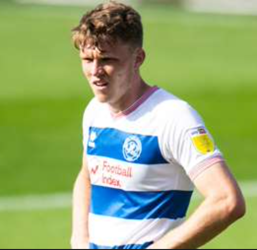 Rob Dickie playing in a QPR shirt with his hands on his hips