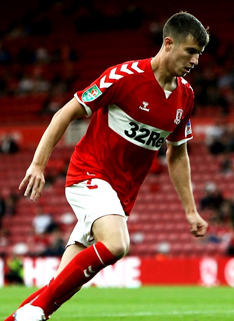 Paddy McNair dribbling the ball during a match