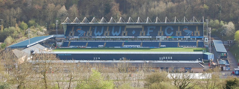 A long view of Adams Park with foliage surrounding it