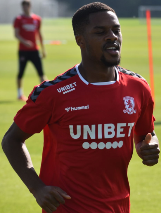 Akpom jogging on in a training kit.
