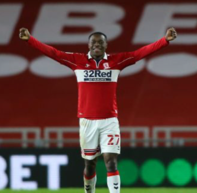 Marc Bola with his arms outstretched, smiling celebrating at the Riverside