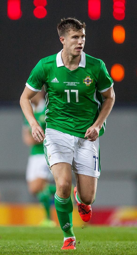 Paddy McNair running around in Northern Ireland's green and white kit