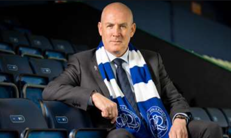 Mark Warburton sat in the stands with a QPR scarf around his neck