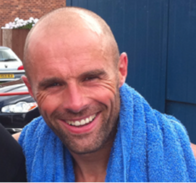Paul Warne in a car park with a towel around his neck