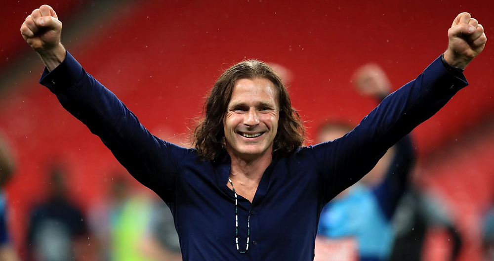 Gareth Ainsworth on the pitch with his fists in the air