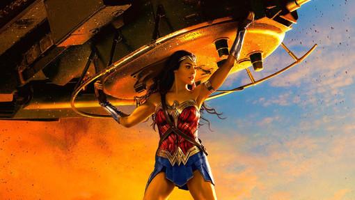 Wonder Woman lifting a tank wallpaper and poster