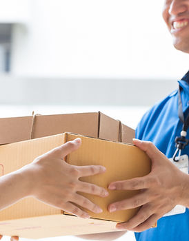 Woman hand accepting a delivery of boxes