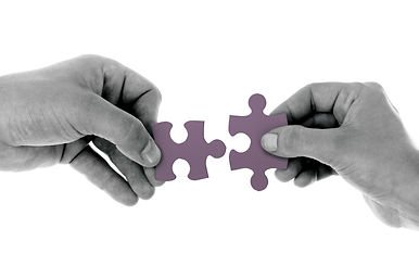 Canva - 2 Hands Holding 1 Jigsaw Puzzle