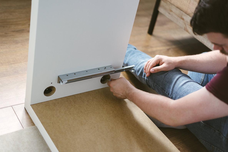 Canva - Photo of Man Assembling Furnitur