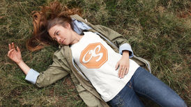 pretty-girl-lying-on-the-grass-while-wea