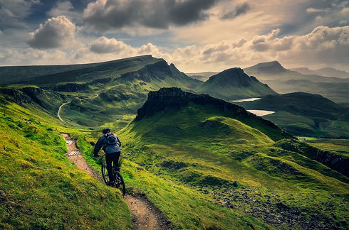 mountain-biker-riding-through-rough-moun