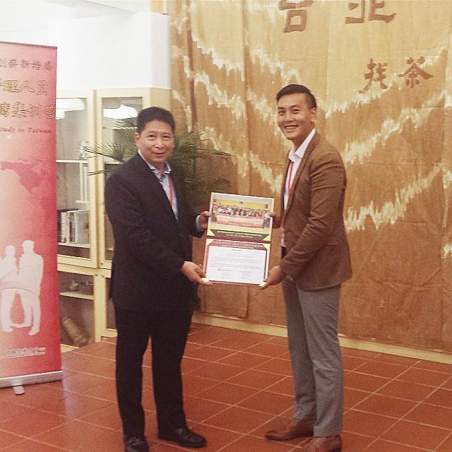 Ken receiving certificate upon completion