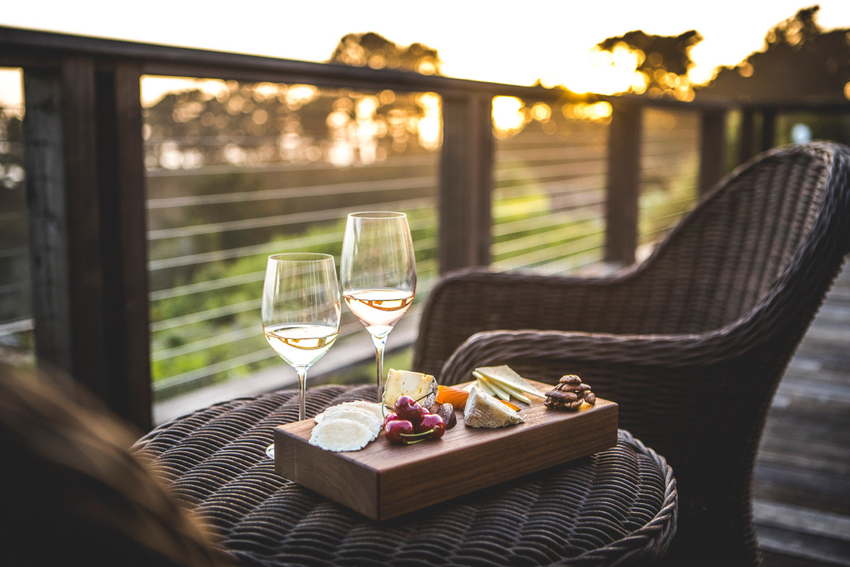 Wine and snacks on balcony with view