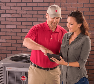 Rheem A/C Technician with New Orleans homenowner