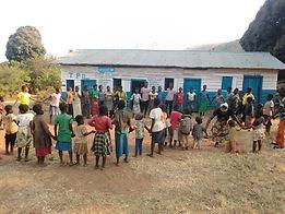 refeades children holding hands child friendly space Congo DRC Makobola orphans