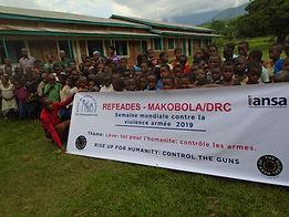 refeades IANSA Global Week of Action Against Gun Violence 2019 Makobola DRC Congo kids happy banner Africa gun violence