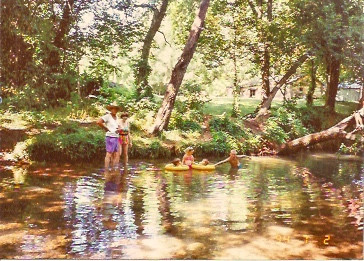The Riley family playing in Flint Creek