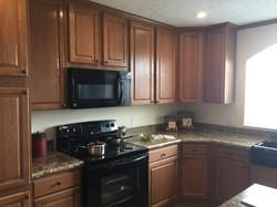 Raised-Panel Oak Cabinets in Kitchen