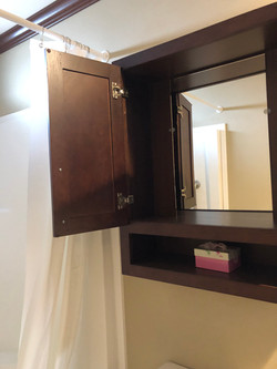 Etagere Cabinet in Guest Bath