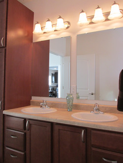 Master Bathroom with Double Sink and Linen Closet