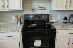 Pot Filler & Ceramic Backsplash