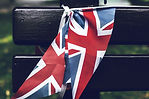 united-kingdom-flag-tied-to-a-wooden-ben