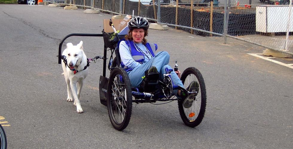 customer with dog and recumbent trike