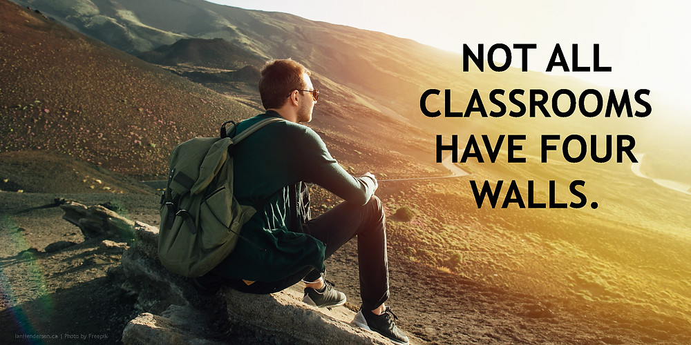 "A hiker overlooks the sunset. Text ""Not all classrooms have four walls"" appears on the graphic."