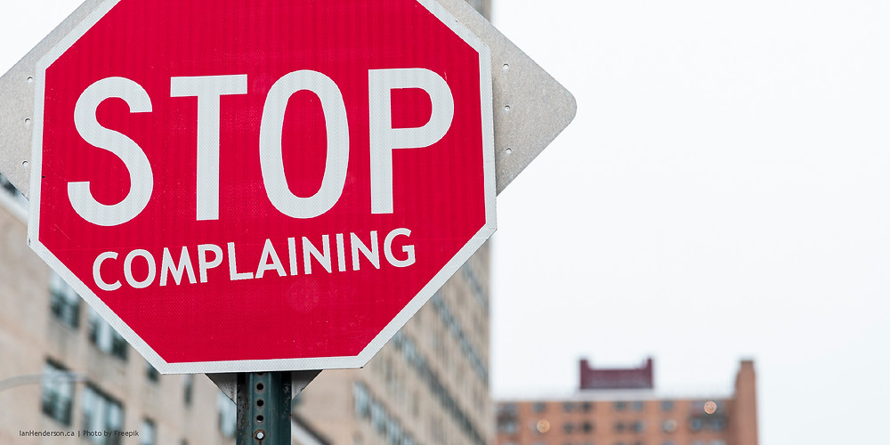 "A picture of a stop sign with the word ""complaining"" written underneath the word ""stop."""