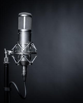 studio microphone on a black background.