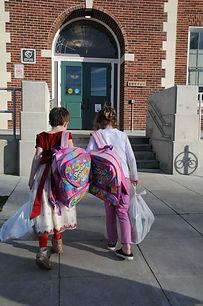 girls entering school.jpeg