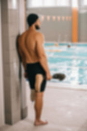 rear view of young swimmer standing at p