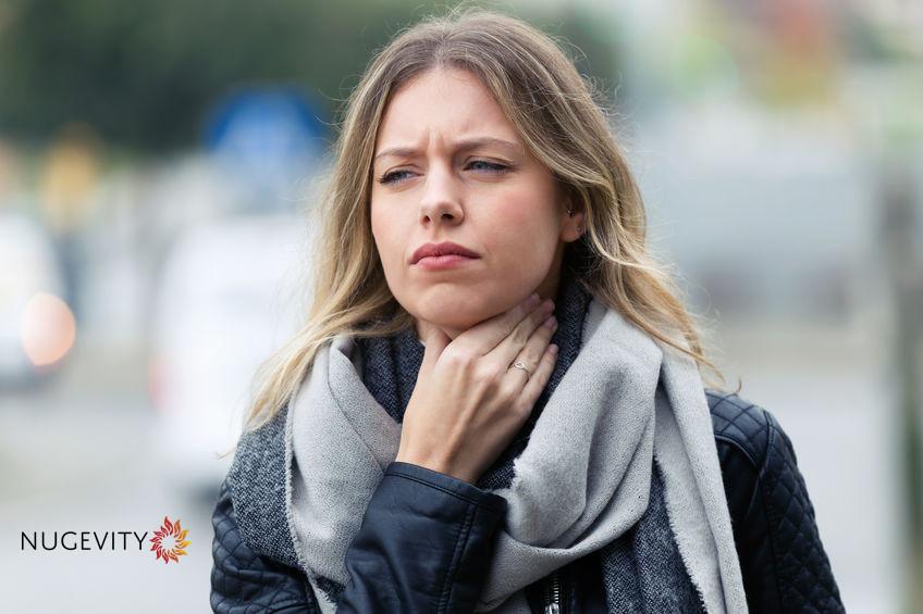 woman sore throat cold flu nugevity